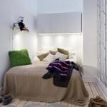 Kleine slaapkamer met bomen behang
