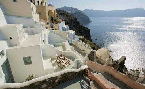 Griekse witte slaapkamer in Santorini
