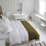 Witte slaapkamer van High Road House