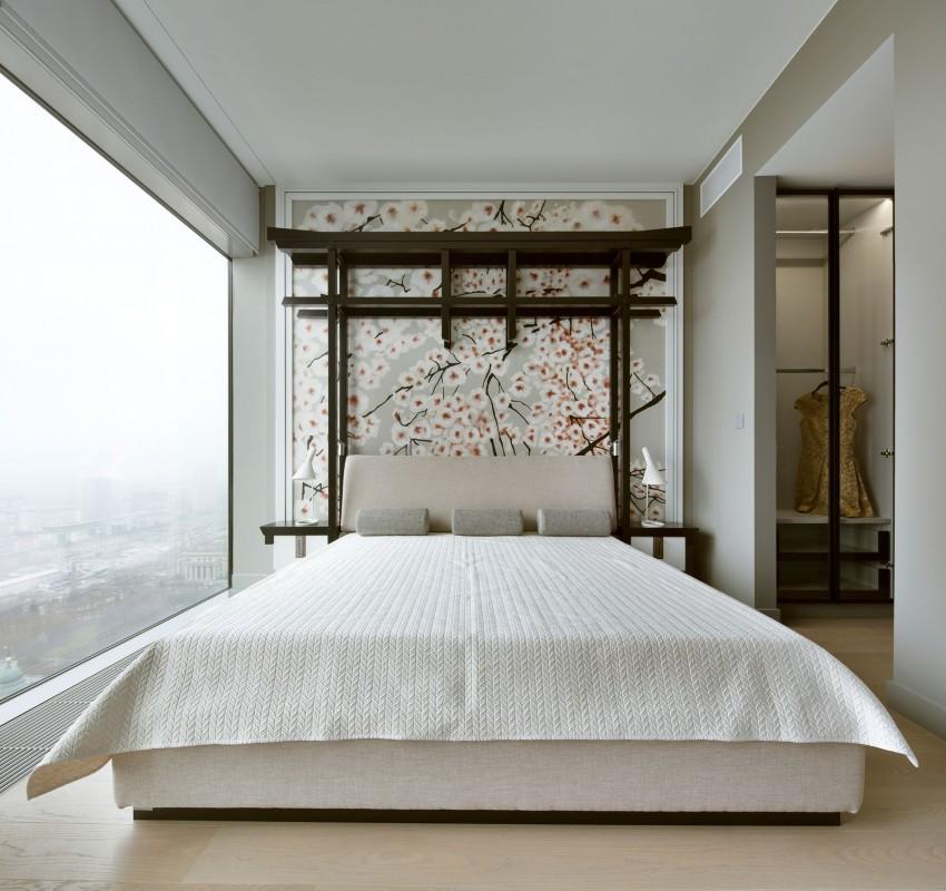 Aziatische slaapkamer met bloesem behang