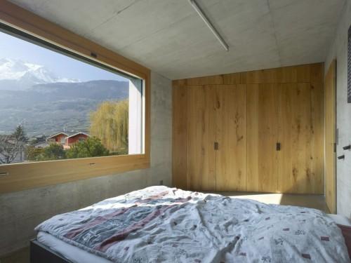 Beton en hout combinatie in slaapkamer ontwerp