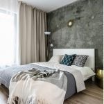Deze kleine slaapkamer heeft een betonmuur!