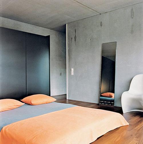 Betonnen muur in slaapkamer