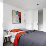 Betonnen vloer in moderne slaapkamer