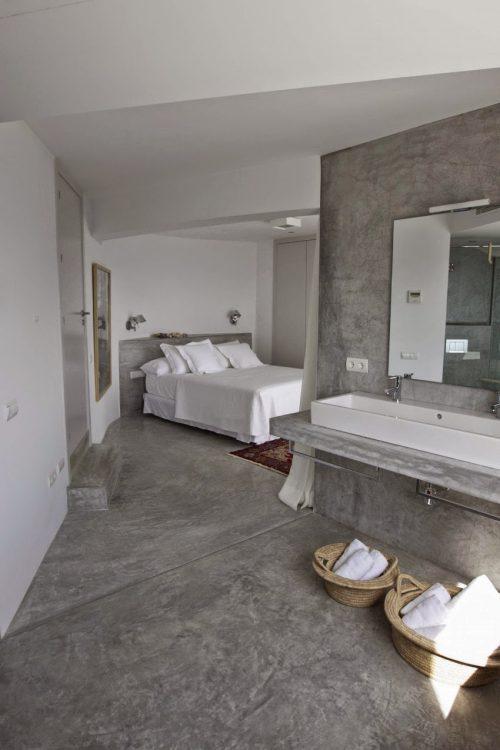 Betonstuc slaapkamer met open badkamer | Slaapkamer ideeën