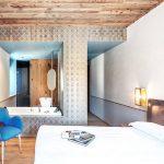 De stijlvolle slaapkamer van het Garden hotel