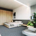 Deze strakke moderne slaapkamer met betonnen muren en plafond