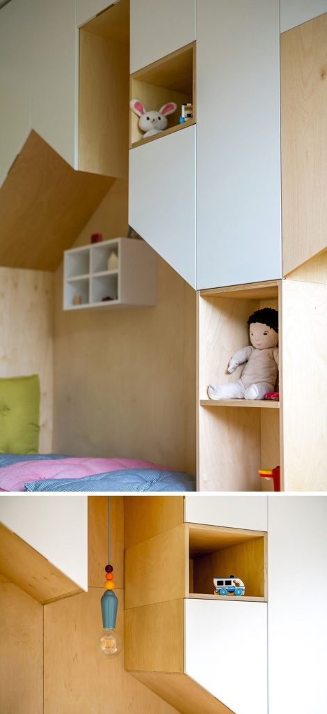 Gedeelde kinderkamer met een multifunctionele wandkast
