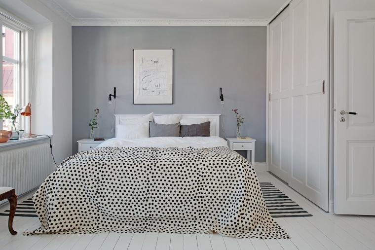 Een grijze muur in een witte slaapkamer