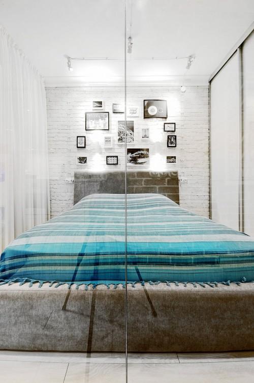 Half open slaapkamer in klein appartement