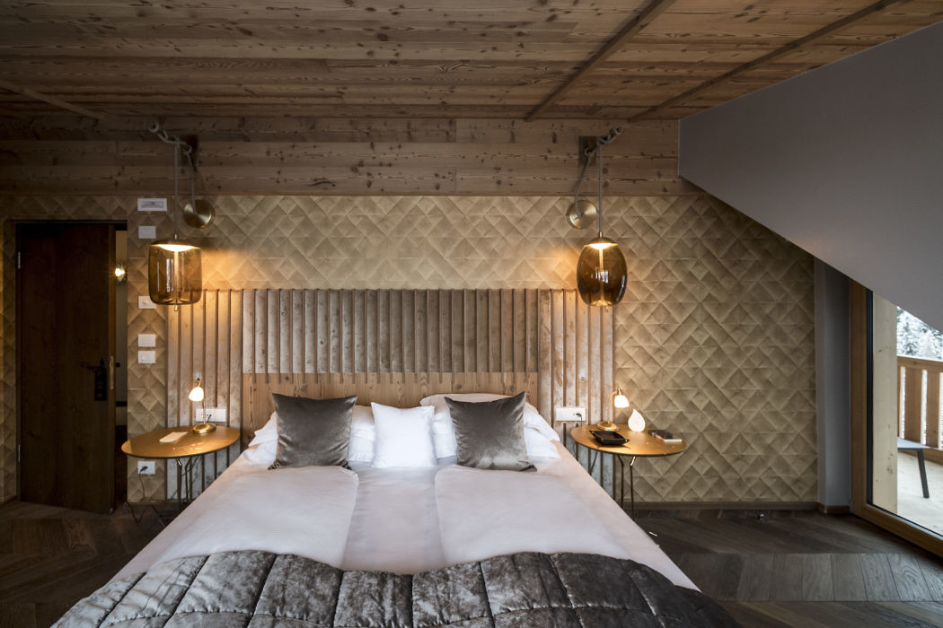 Luxe slaapkamer van een rustiek appartement in de Alpen