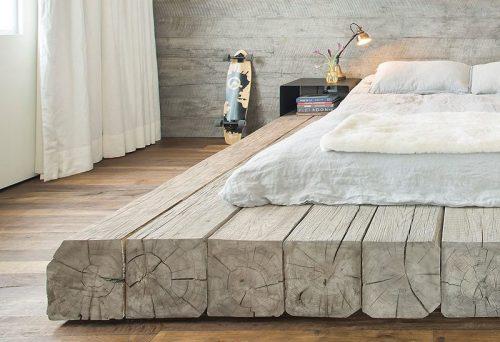 Marine loft slaapkamer met boomstam bed