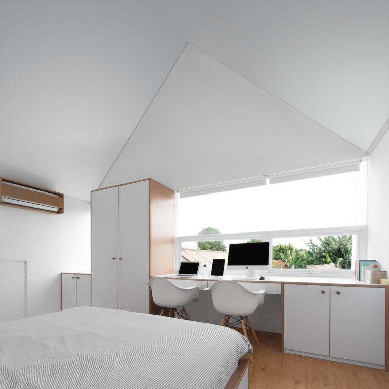 Minimalistische open slaapkamer op vide