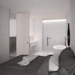 Moderne slaapkamer met ruime open badkamer