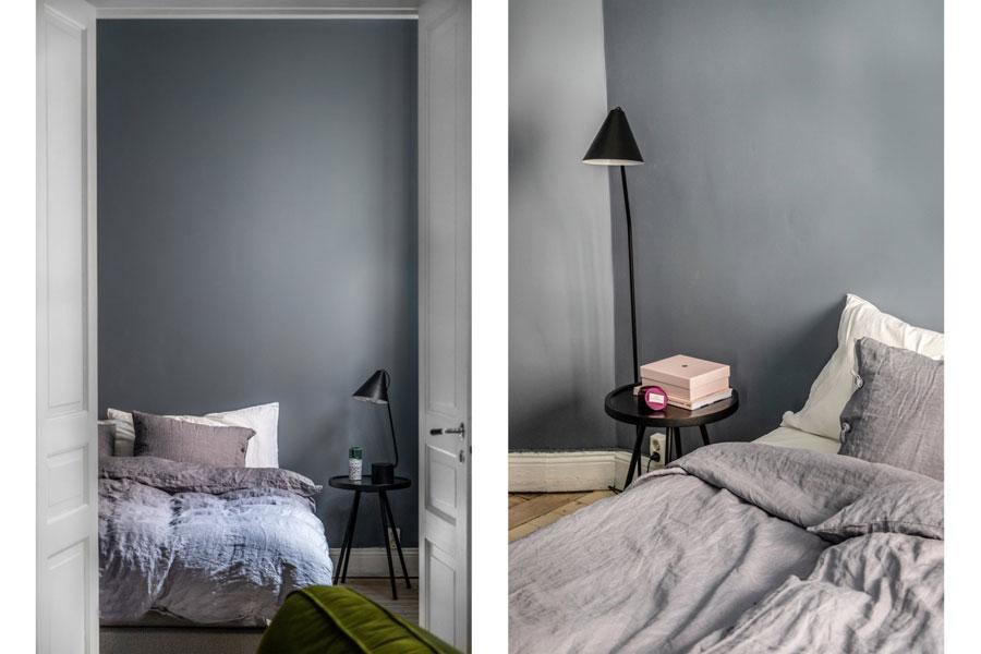 Mooie minimalistische slaapkamer met grijze muren