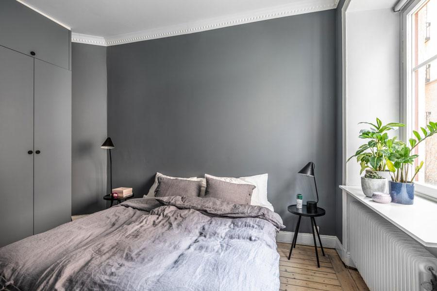 Mooie minimalistische slaapkamer met grijze muren for Mooie slaapkamer