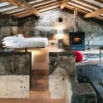 Natuurlijke slaapkamer van boetiekhotel Monaci Delle Terre Nere