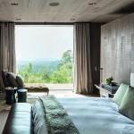Natuurlijke slaapkamer met houten muren