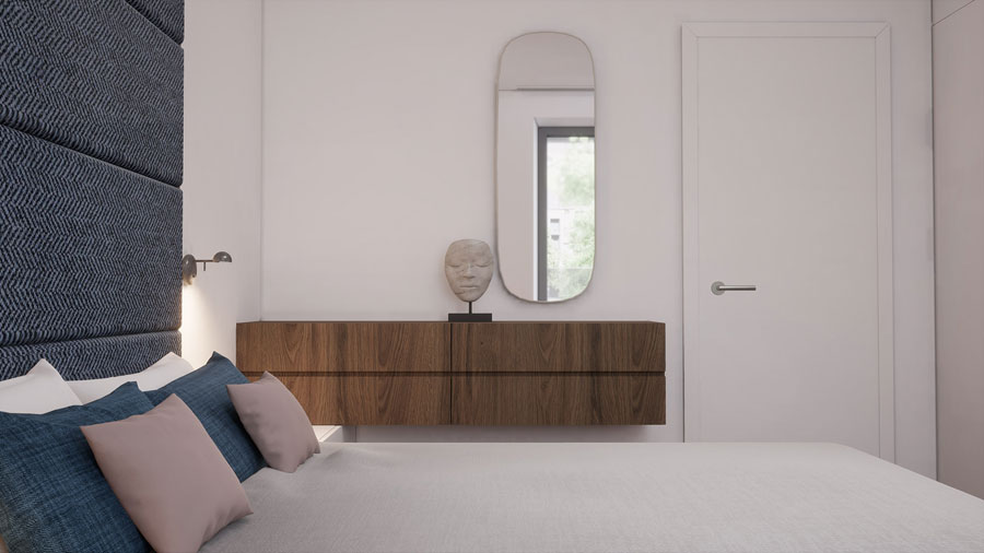 Ruime lichte slaapkamer met een grote kledingkast en een werkplek