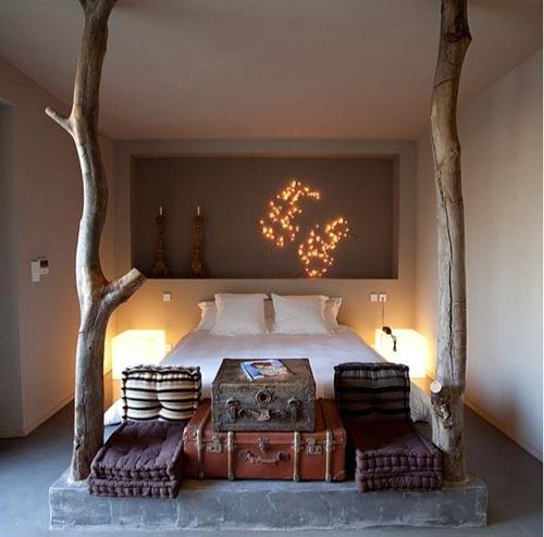Rustieke slaapkamer met boomstammen  Slaapkamer ideeën