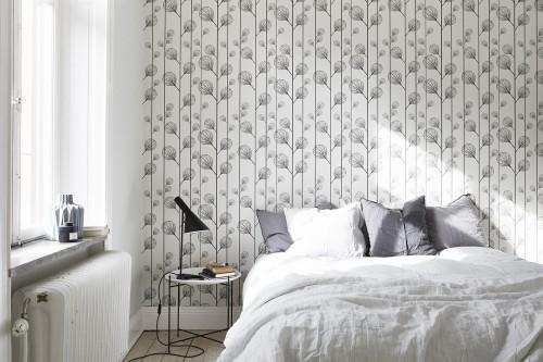 Scandinavische slaapkamer met mooi behang