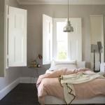 Slaapkamer met klassieke houten shutters