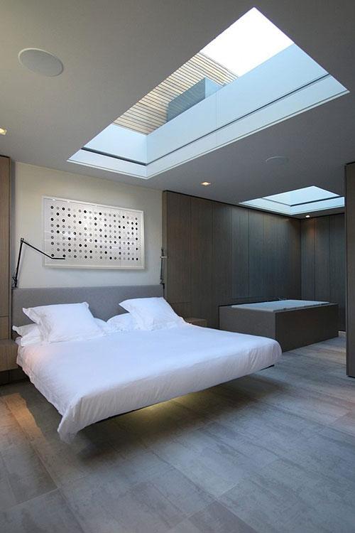 Slaapkamer met sterrenhemel uitzicht
