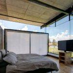 Slaapkamer van een industriële containerwoning