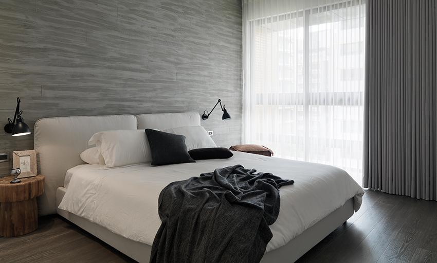 Slaapkamer waar luxe en industrieel gecombineerd zijn