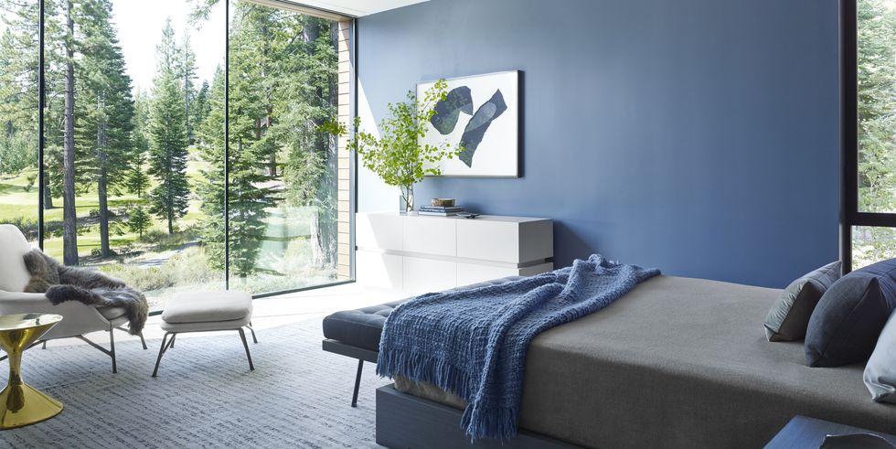 Slaapkamer met zen blauwe muren