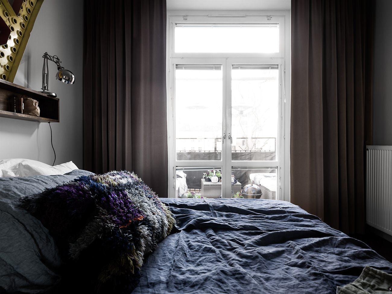 Stoere Scandinavische slaapkamer met grijze muren
