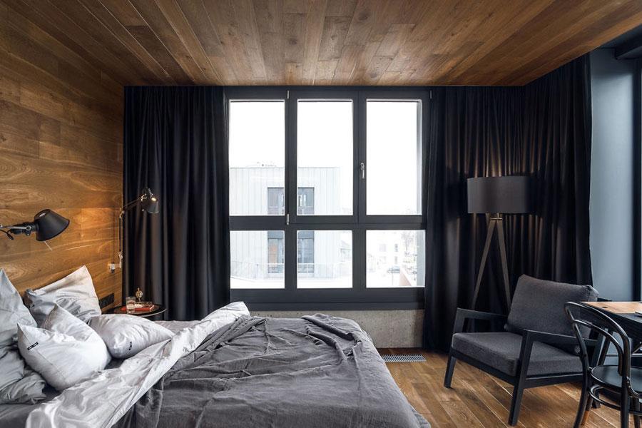 Stoere slaapkamer met beton en hout door Blackhaus