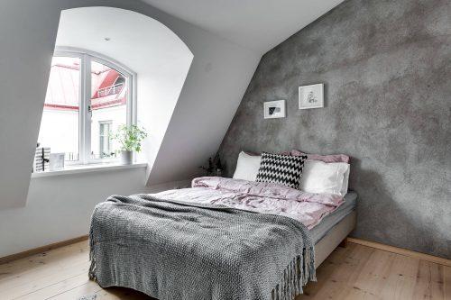 stoere-slaapkamer-met-inbouwkast-in-schuine-wand