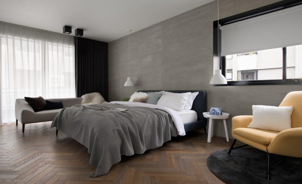 Stoere slaapkamer suite met werkplek en loungehoek