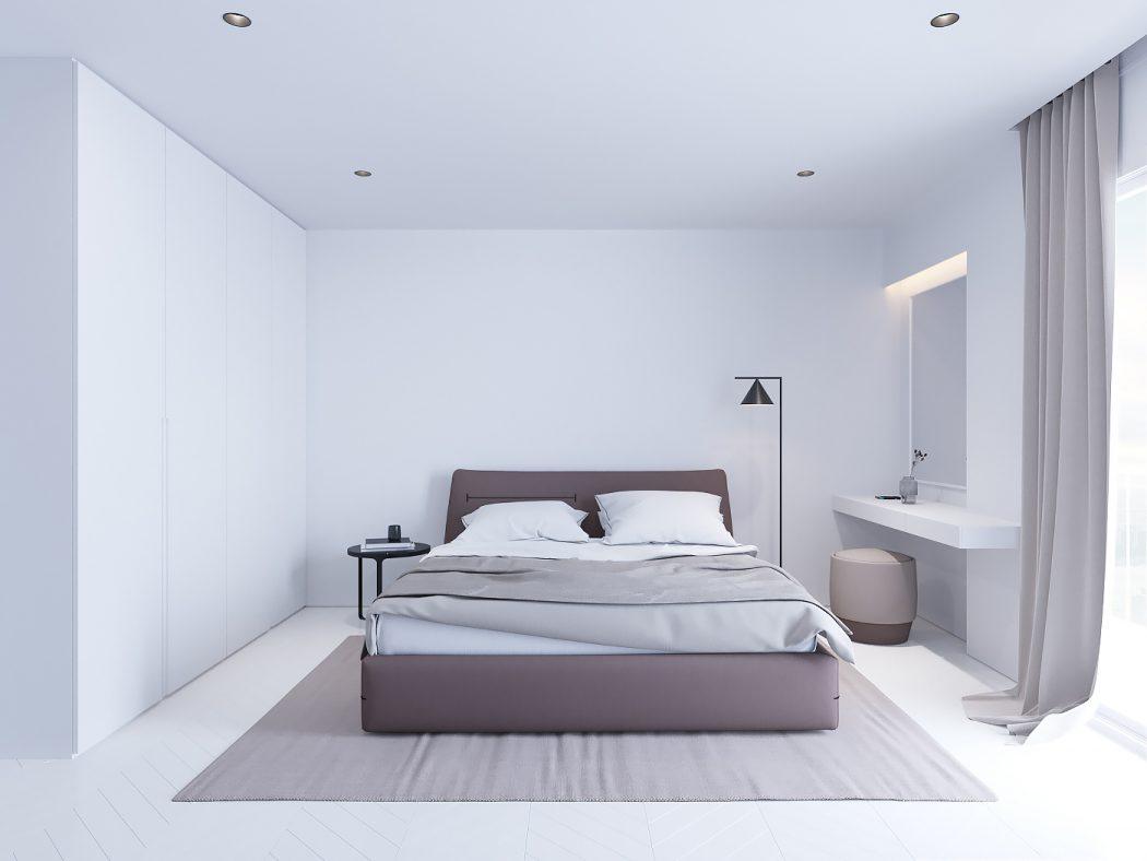 Strakke witte minimalistische slaapkamer met bruin en zwarttinten