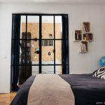 Tussenkamer slaapkamer in een klein appartement uit Parijs