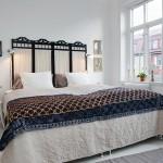 Witte slaapkamer met Aziatische accessoires