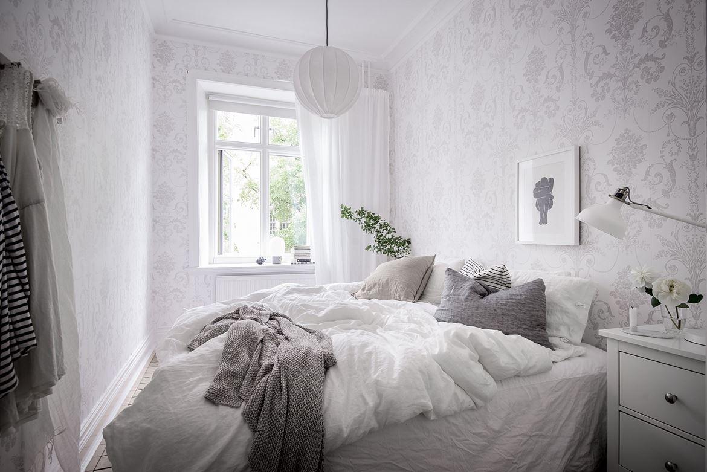 Zweedse slaapkamer met een romantische sfeer